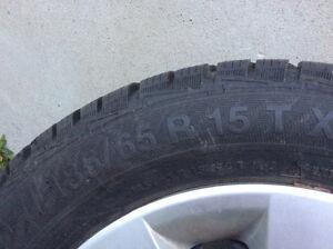 4 pneus d'hiver gislaved 185/65 R15 avec rim et enjoliveur