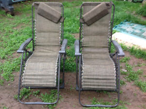 2 RECLINING FOLDING CHAIRS WITH HEAD SUPPORT -EACH $25