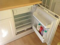Integrated fridge with top ice box