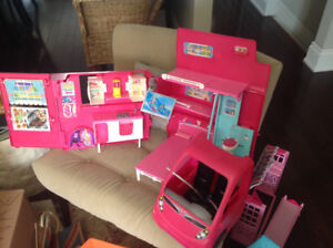 A lot of Barbie toys, Barbies and accessories corvette, plane