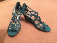 Size 6 turquoise wedged heels