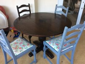 Solid oak round extendable dining table and four chairs-Cath Kidston seat pads