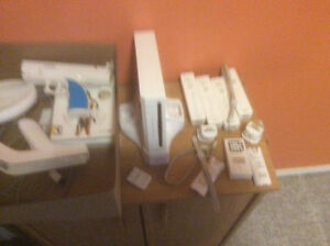 Nintendo Wii with Guitar hero and 3 other games