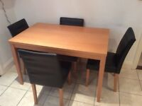 Modern beech dining table and 4 chairs.