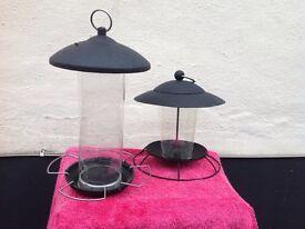 Two bird feeders