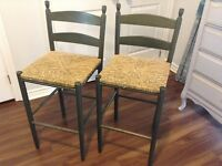 2 green stained bar stools