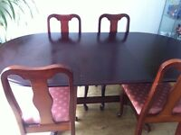A solid wood dining table & 4 chairs