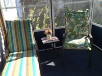 Two patio chair cushions and one matching lounge cushion
