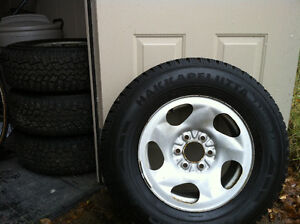 4 Studded HAKKAPELIITTA TIRES ON STEEL RIMS