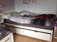 IKEA single bed with mattress and storage boxes