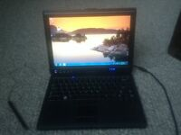 DELL XT    CONVERTIBLE TABLET