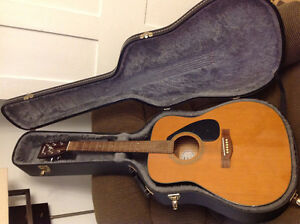 Yamaha acoustic guitar and hard case