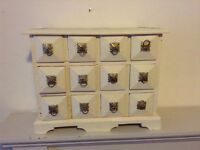 Small nest of 12 drawers. Cream painted with brass knobs
