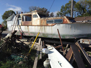 This steel boat inboard solid but needs TLC