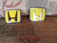 Pair of yellow Honda badges