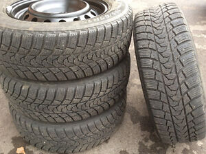 4 - 2 year old winter tires with new rims