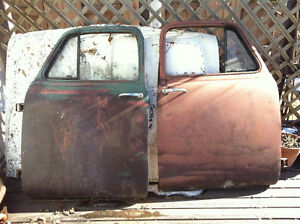 1947 - 1954 Chevy 3100 doors. NO RUST. all glass