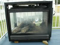 FIREPLACE  THREE SIDED   IN GOOD WORKING ORDER OBO