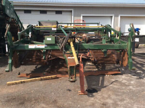 LOCKWOOD MODEL 5000 FOUR ROW WINDROWER