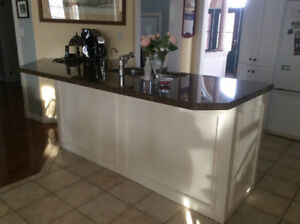 Cabinets, countertops, sink, taps