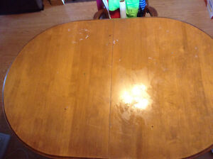 Large dining table with chairs and two leafs