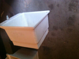 White plastic laundry tubs 24x24 in