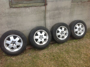 Set of Volvo XC 16 inch aluminum rims with tires