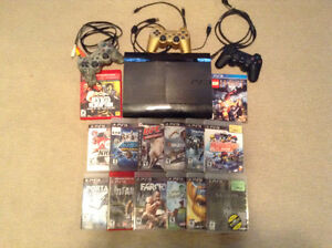 PS3 slim with 14 games 3 controllers 2 chargers and main cords