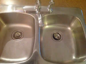 Like new sink and faucet-- Moen