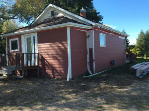 Small house on 1/2 acre