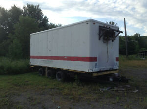 moose cooler in storage container on trailer