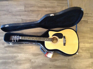 Giovanni acoustic electric guitar with case brand new.