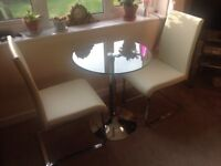 Small glass top table with two chairs