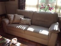 Cream leather couches 2 seater 3seater and poufie