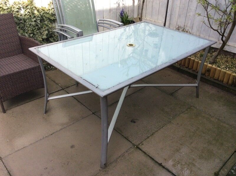 Large Glass Topped Out Door Table With Four Chairs