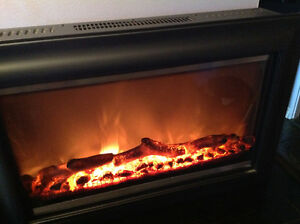 Electric Remote Controlled Log Fireplace/Like New West Island Greater Montréal image 1