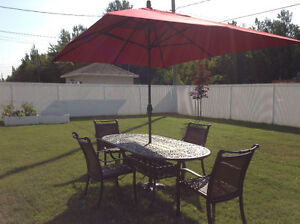 Patio table, umbrella and six chairs