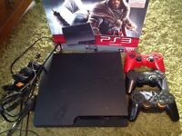 PS3 console 26 games 3 controllers and all cables