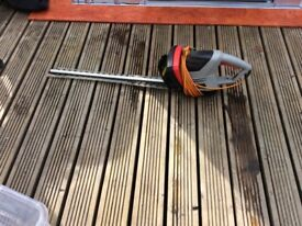 Garden electric hedge trimmer