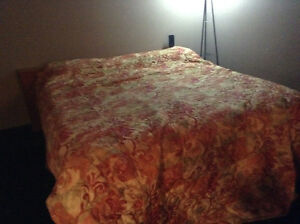 Near new pillow top King size mattress and frame.  near new