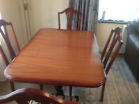 Superb solid wood extendable dining table and chairs