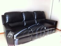 Black sofa with dual recliners