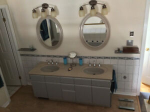 """66"""" bathroom vanity with double sinks, countertop, and mirrors"""