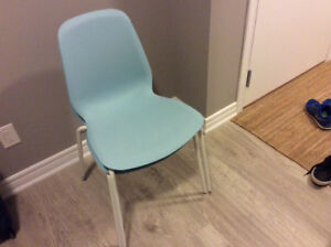 4 Blue stackable chairs