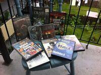 10 jeux PS2 + console PS2 = 20$