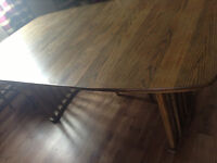 Large dining table with two extensions for sale