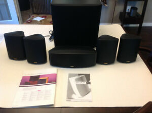 Paradigm surround sound speakers with subwoofer.