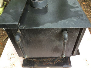 Wood stove with inserted boiler