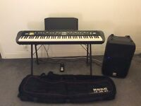 Full Professional Piano Rig, comprising Korg SV1, stand, wheeled case, pedal, and amp.