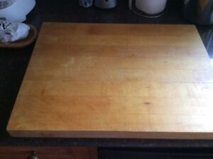 Thick wooden chopping board, stock pot